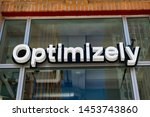 optimizely sign and logo on... | Shutterstock . vector #1453743860