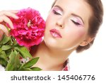 woman with pink flower | Shutterstock . vector #145406776
