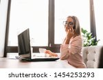business woman on the phone at...   Shutterstock . vector #1454253293