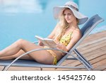 young woman in bikini  hat and  ... | Shutterstock . vector #145425760