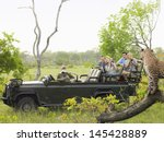 side view of tourists in jeep... | Shutterstock . vector #145428889