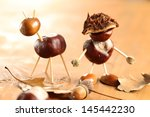chestnut and acorn figurines on ... | Shutterstock . vector #145442230
