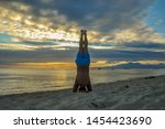 Headstand On The Beach With A...