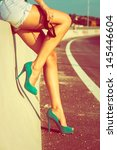 woman tan legs in high heel... | Shutterstock . vector #145446604