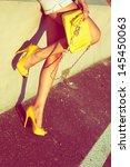 Woman  Tan Legs In Yellow High...