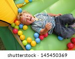 2 Year Old Boy Smiling On An...