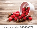 assorted berries on old wooden... | Shutterstock . vector #145456579