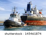 Cargo Ship And Tugboat