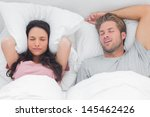 woman annoyed by the snoring of ...   Shutterstock . vector #145462426