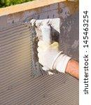 man spreading tile adhesive... | Shutterstock . vector #145463254