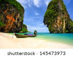 tropical beach with limestone... | Shutterstock . vector #145473973