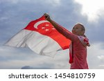 singapore flag waving on wind... | Shutterstock . vector #1454810759