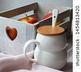 Mug On The Table. Box Of Apple...