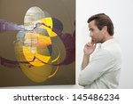 thoughtful man looking at wall... | Shutterstock . vector #145486234