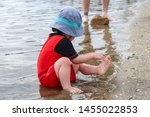 Young Child Playing In Water At ...