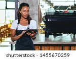 young barista using digital... | Shutterstock . vector #1455670259