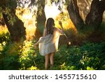 girl stands with her back... | Shutterstock . vector #1455715610