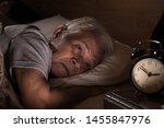Depressed Senior Man Lying In...