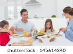 family eating pasta with sauce... | Shutterstock . vector #145614340
