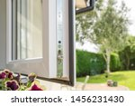 Small photo of Cambridgeshire, UK - Circa July 2019: Brand new isntalled double glazing windows seen in a house annex. Detail of the multiple window locks can rubber window sealing is visible, adjacent to a garden.