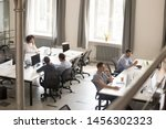 Small photo of Top view of diverse people working together on computer performing daily routine tasks in coworking space, multiracial millennial men and women busy using devices discussing projects in shared office