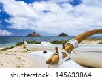 an outrigger canoe sits at the...