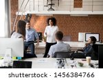 multiracial young colleagues... | Shutterstock . vector #1456384766