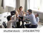 diverse millennial colleagues... | Shutterstock . vector #1456384793