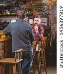 friends relaxing in pub.... | Shutterstock . vector #1456397819