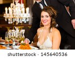 pretty woman sitting at a table ... | Shutterstock . vector #145640536