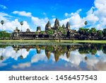 Small photo of Angkor Wat ancient temple reflection in water lake. Angkor Wat is an UNESCO world heritage site near Siem Reap, Cambodia.