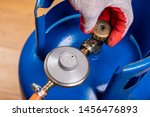 Reducer And Gas Cylinder For...