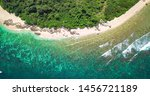 Jiajing Island, an Uninhabited Small Island with White Sand Beache and Coral Reef, Close to the Coast of Shimei Bay in South China Sea, Wanning County, Hainan, China. Aerial Nature Landscape.