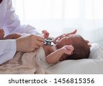Small photo of Asian newborn baby get sick crying during examine by pediatrician hold stethoscope, pediatric doctor monitoring heart pulse rate adorable infant crying in clinic, pediatrician with child concept