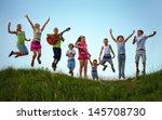happy kids jumping on summer... | Shutterstock . vector #145708730