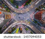 Aerial view of cars and trains with intersection or junction with traffic, Taipei Downtown, Taiwan. Financial district and business area. Smart urban city technology.