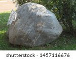 Small photo of YAROSLAVL, RUSSIA - SEPTEMBER 08, 2018: the stumbling stone - a huge boulder with a reminder of a dispute about the beard