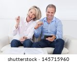 portrait of a couple sitting on ... | Shutterstock . vector #145715960