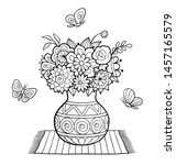 Vase Of Flowers Standing On A...
