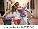 happy couple with bikes in the... | Shutterstock . vector #145719368