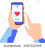 hand holding phone with heart... | Shutterstock .eps vector #1457222549
