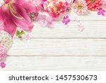 Pink Flowers On White Wooden...