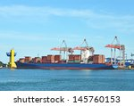 container stack and ship under... | Shutterstock . vector #145760153