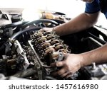 Car Mechanic In Garage With Car ...