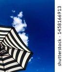 stripy umbrella against a deep...   Shutterstock . vector #1458166913