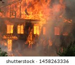 Burning house. Big wooden building completely destroyed by fire