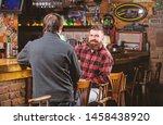 men relaxing in pub. weekend... | Shutterstock . vector #1458438920