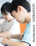 elementary school student doing ... | Shutterstock . vector #1458439229
