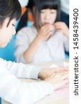 elementary school student doing ... | Shutterstock . vector #1458439400