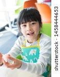 elementary school student doing ... | Shutterstock . vector #1458444653